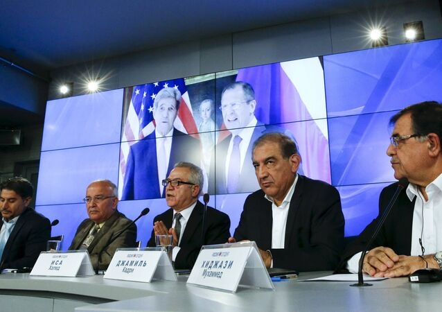 Syrian opposition members attend a news conference, ahead of new round of crisis talks in Vienna on Saturday, in Moscow, November 12, 2015