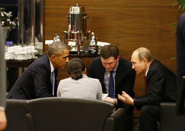 U.S. President Barack Obama, left, speaks with Russian President Vladimir Putin, right prior to the opening session of the G-20 summit in Antalya, Turkey, Sunday, Nov. 15 2015