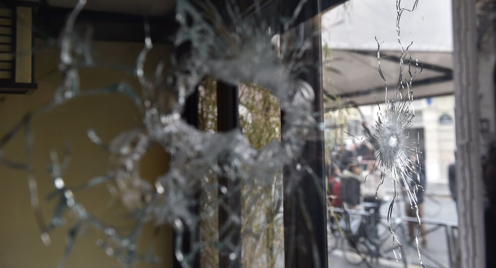 Bullet holes are seen in the window of a Japanese restaurant next to the cafe 'La Belle Equipe' at the Rue de Charonne in Paris on November 14, 2015, following a series of coordinated attacks in and around Paris late Friday