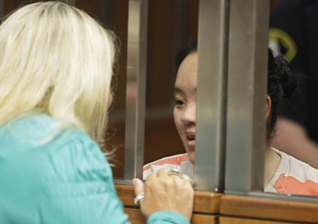 Ka Yang, right, talks with her court appointed attorney, Linda Parisi during a hearing in Sacramento County Superior Court in Sacramento, Calif. on Friday, Aug. 26, 2011 for the alleged murder of her 6-week old daughter. Yang has not entered a plea in the death of her daughter who authorities believe died from burns suffered inside a microwave oven.