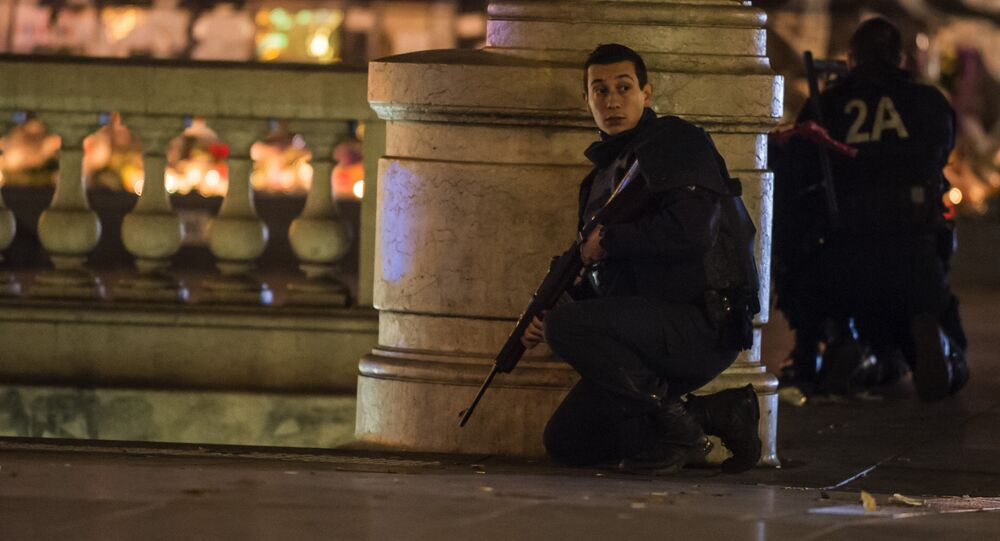 French police officers take position on Place de la Republique (Republic Square), after allegedly false alert sparked mass panicc amongst the gathered crowd in Paris, Sunday, Nov. 15, 2015