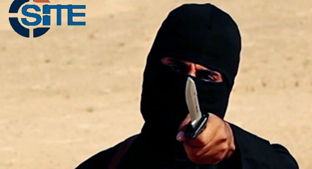 This image made from militant video, which has been verified by SITE Intel Group and is consistent with other AP reporting, shows Mohammed Emwazi , known as Jihadi John, holding a knife