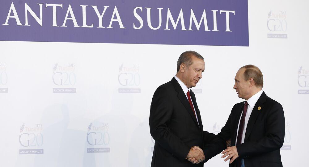 Turkish President Recep Tayyip Erdogan (L) greets Russian President Vladimir Putin (R) during the 'Welcoming Ceremony' prior to the G20 Turkey Leaders Summit on November 15, 2015 in Antalya