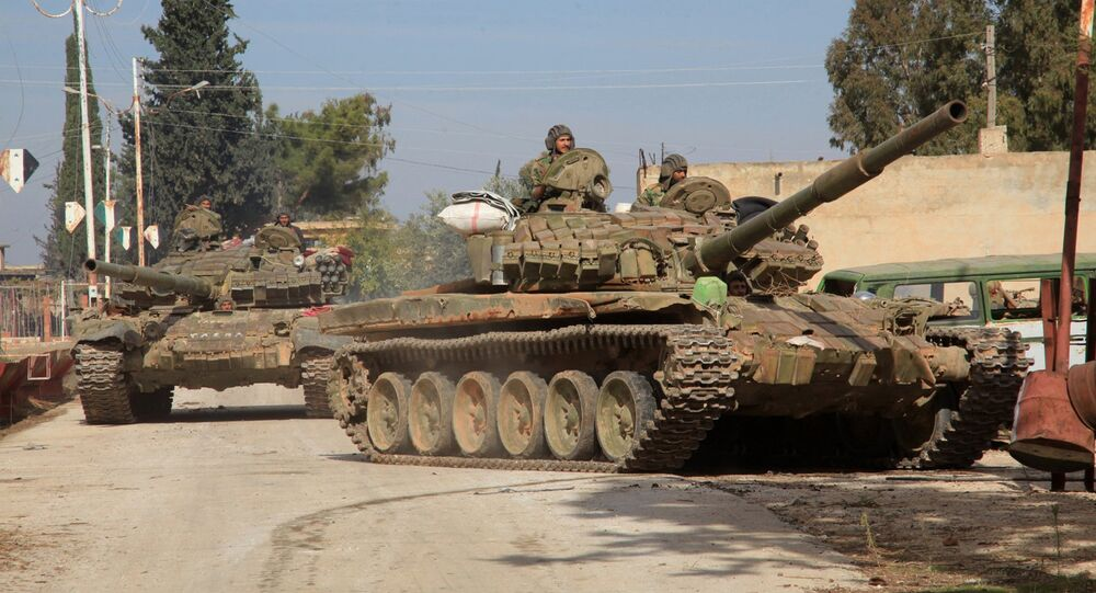 Syrian army tanks enter a village near the Kweyris military air base, in the east of the northern Syrian province of Aleppo, after they took control of the surrounding villages from Daesh militants .file photo
