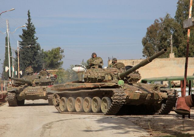 Syrian Army tanks enter a village near the Kweyris military air base in the northern province of Aleppo after the army took control of the surrounding villages from Daesh terrorists. file photo