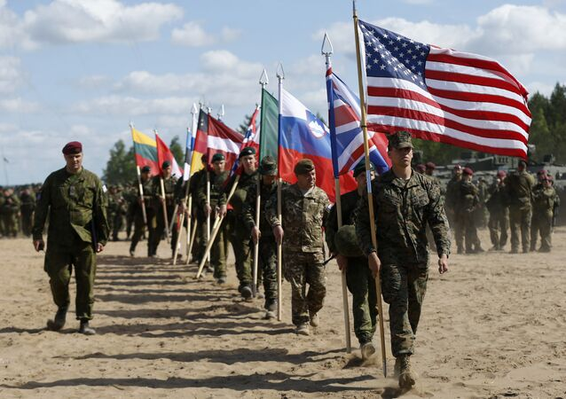 Soldiers from NATO countries attend an opening ceremony of military exercise 'Saber Strike 2015', at the Gaiziunu Training Range in Pabrade some 60km.(38 miles) north of the capital Vilnius, Lithuania, Monday, June 8, 2015