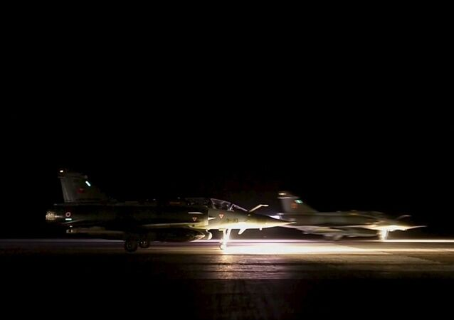 French fighter planes prepare to take off from an unidentified location in this still image taken from handout video released on November 16, 2015. French warplanes pounded Islamic State positions in Syria on November 15, 2015 as police in Europe widened their investigations into coordinated attacks in Paris that killed more than 130 people