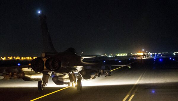 A French fighter jet taxis along the runway in an undisclosed location, in this handout picture released by the ECPAD late November 15, 2015 - Sputnik International