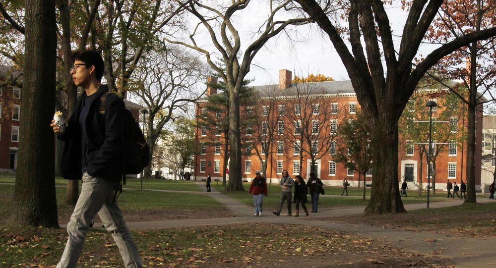 A student walks through Harvard Yard at Harvard University in Cambridge, Massachusetts, in this file photo taken November 16, 2012