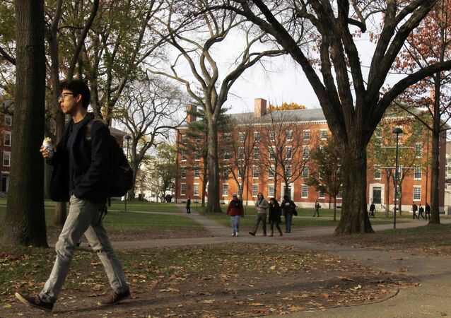 A student walks through Harvard Yard at Harvard University in Cambridge, Massachusetts, in this file photo taken November 16, 2012
