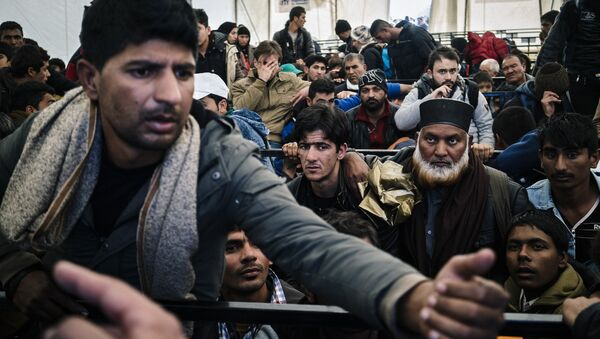 A man argues as he waits along with other migrants and refugees, at a registration camp after crossing the Greek-Macedonian border near Gevgelija on November 14, 2015 - Sputnik International