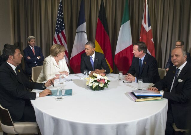 (L to R) Italian Prime Minister Matteo Renzi, German Chancelor Angela Merkel, US President Barack Obama, British Prime Minister David Cameron and French Foreign Minister Laurent Fabius attend a meeting during the G20 Summit in Antalya, on November 16, 2015