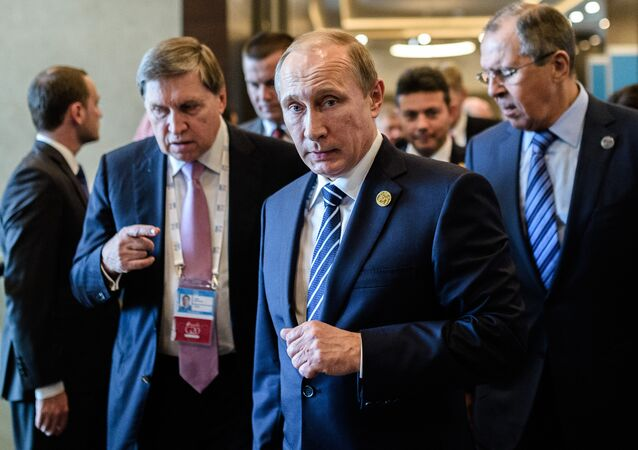 Russian President Vladimir Putin (C) arrives on day two of the G20 Turkey Leaders Summit on November 16, 2015 in Antalya. Putin said on November 16 that the attacks in Paris showed the need for his proposal for an international anti-terror coalition to be realised