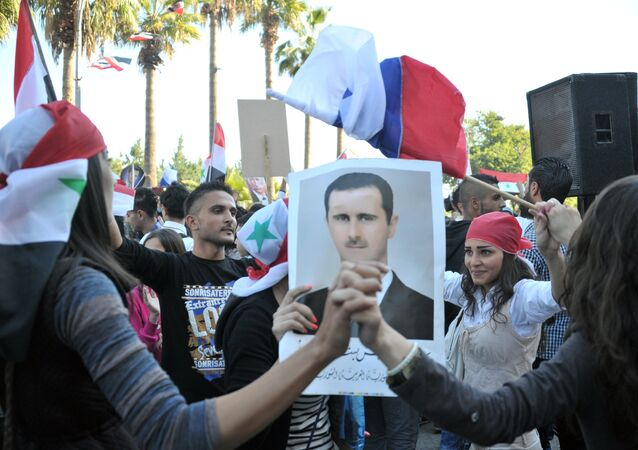 Participants of a rally in Tarus in support of the Russian Aerospace Force operation in Syria
