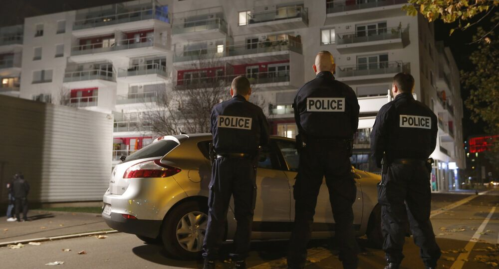 French police secure the area outside a housing comples as police conduct a door-to-door search operation in the Neudorf neighborhood in Strasbourg, France, November 16, 2015