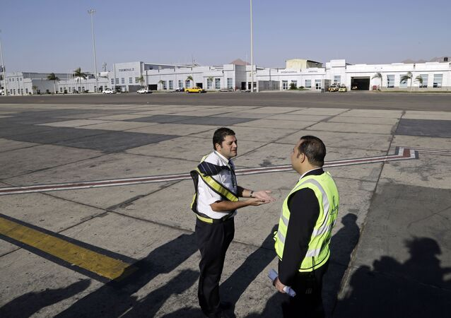 Ground personnel oversee the departure of an Egyptair Express flight bound for Cairo at Sharm el-Sheikh Airport in south Sinai, Egypt, Monday, Nov. 9, 2015