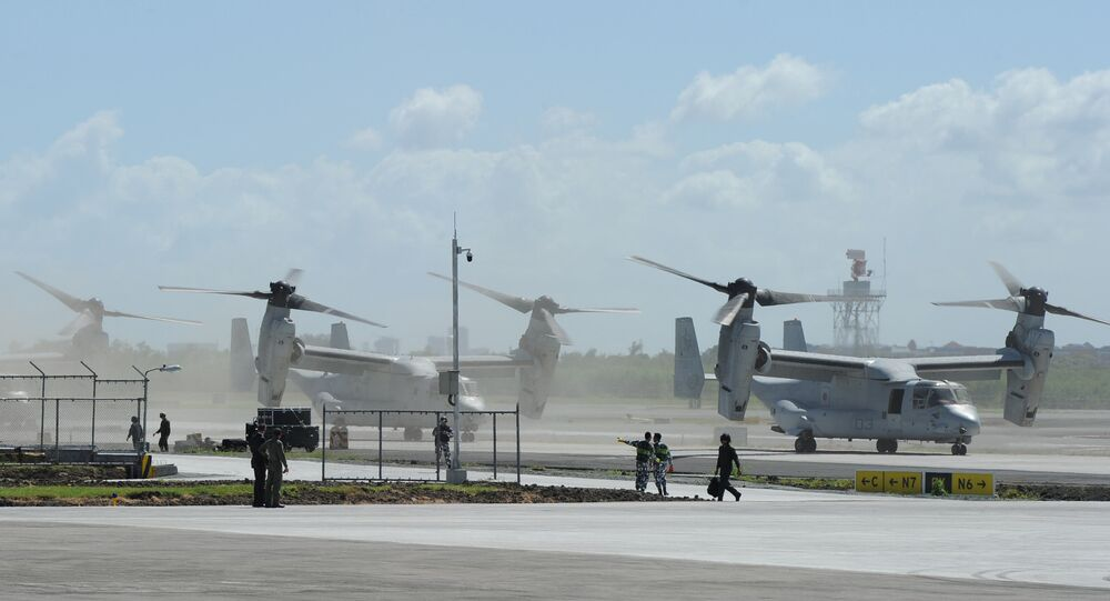 US Marine V-22 Osprey aircraft (R) taxi on the tarmac after the arrival of US President Barack Obama at the international airport in Manila on November 17, 2015, to attend the Asia-Pacific Economic Cooperation (APEC) summit