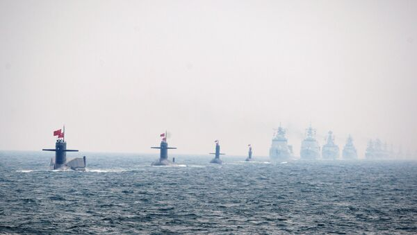 Four Chinese Navy submarines (L) and warships attend an international fleet review to celebrate the 60th anniversary of the founding of the People's Liberation Army Navy on April 23, 2009 off Qingdao in Shandong Province - Sputnik International