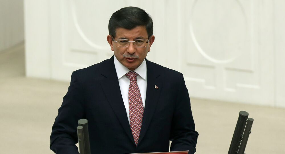 Turkey's Prime Minister Ahmet Davutoglu takes his oath at the Turkey's Parliament that kicks off new term following the Nov. 1 elections, in Ankara, Turkey, Tuesday, Nov. 17, 2015