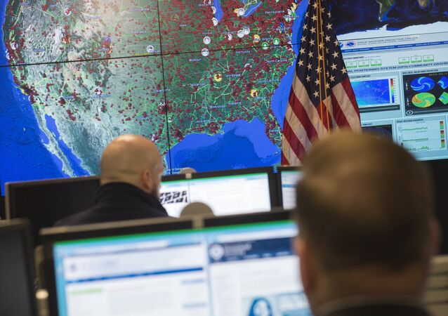 Staff members sit at their work stations at the National Cybersecurity and Communications Integration Center in Arlington, Virginia, January 13, 2015