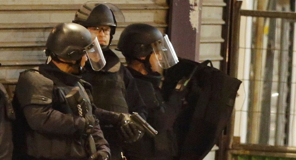 French special police forces secure the area as shots are exchanged in Saint-Denis, France, near Paris, November 18, 2015 during an operation to catch fugitives from Friday night's deadly attacks in the French capital