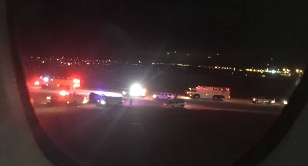 Emergency personnel are shown on the tarmac at Salt Lake City International Airport in this photograph taken by passenger Keith Rosso from a seat inside Air France flight 65, November 17, 2015