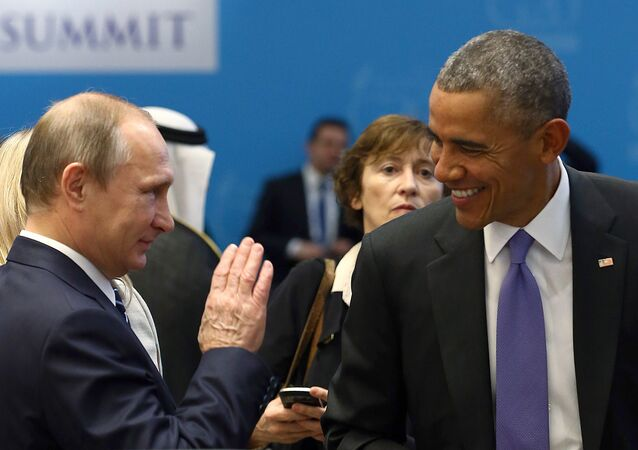 U.S. President Barack Obama (R) chats with Russia's President Vladimir Putin prior to a working session at the Group of 20 (G20) leaders summit in the Mediterranean resort city of Antalya, Turkey, November 16, 2015