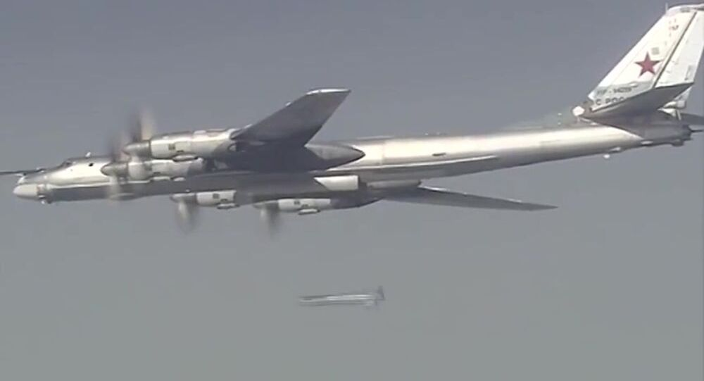 A Russian Tupolev 160 long-range bomber launches a massive air strike on the Islamic State infrastructure in Syria