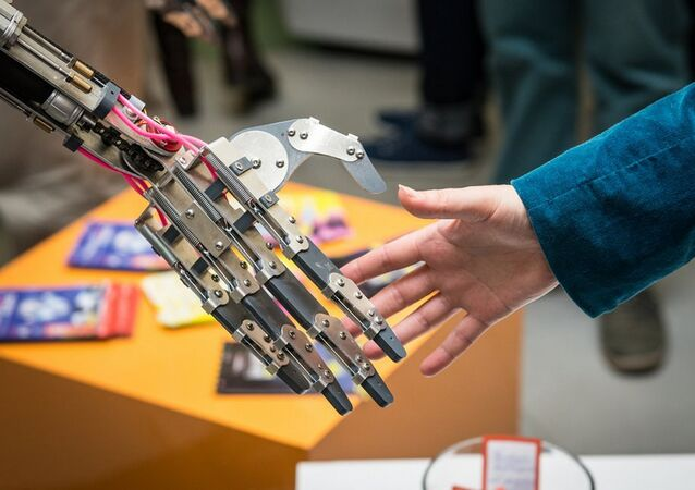 Man And Man-Made: Robot Shakes Hand of Creator