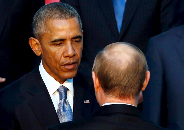 U.S. President Barack Obama shakes hands with Russia's President Vladimir Putin (back to camera) as they gather for a family photo with fellow world leaders at the start of the G20 summit at the Regnum Carya Resort in Antalya, Turkey, November 15, 2015