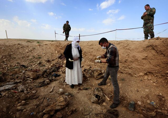 Members of the Yazidi minority search for clues on February 3, 2015, that might lead them to missing relatives in the remains of people killed by the Islamic State (IS) jihadist group.