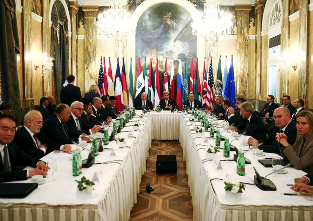Russia's Foreign Minister Sergei Lavrov (centre R), U.S. Secretary of State John Kerry (C) and foreign ministers attend a meeting in Vienna, Austria