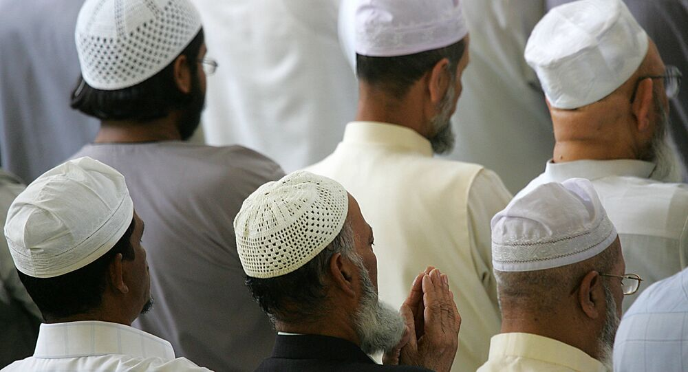 Muslims pray during Friday prayer