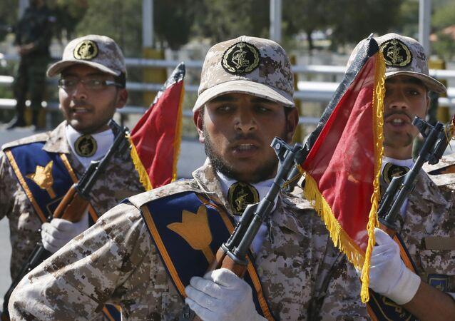 Iran's Revolutionary Guard troops march in a military parade.