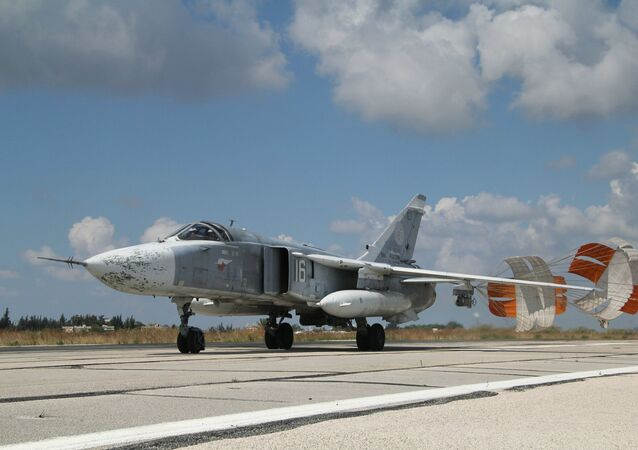 A Russian Su-24 front-line bomber jet lands at Latakia airport, Syria.