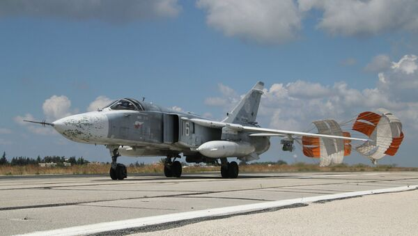 A Russian Su-24 front-line bomber jet lands at Latakia airport, Syria. - Sputnik International