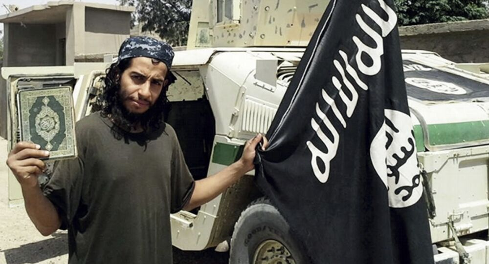 This undated image made available in the Islamic State's English-language magazine Dabiq, shows Belgian Abdelhamid Abaaoud