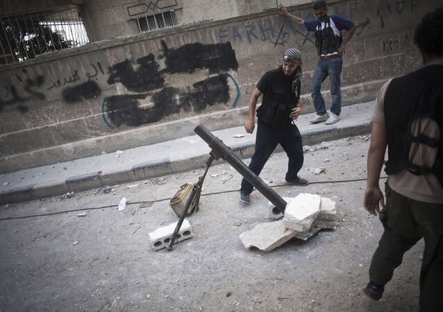 A Free Syrian Army fighter shoots a mortar against Syrian Army positions in the Izaa district in Aleppo, Syria, Tuesday, Sept. 11, 2012.