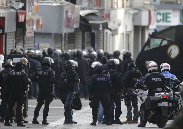 Members of French special police forces of the Research and Intervention Brigade (BRI) are seen near a raid zone in Saint-Denis, near Paris, France, November 18, 2015