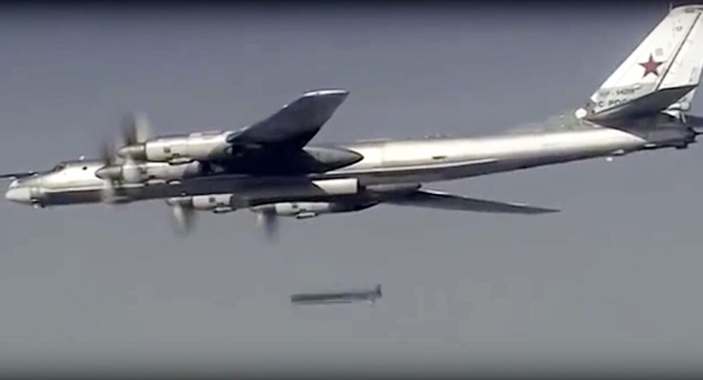 Russian Tu-95 bomber launches a cruise missile at a target in Syria