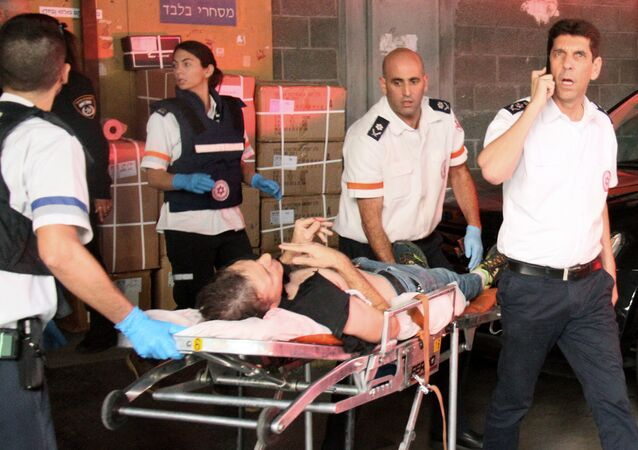 A wounded Israeli man is evacuated following a stabbing attack in Tel Aviv