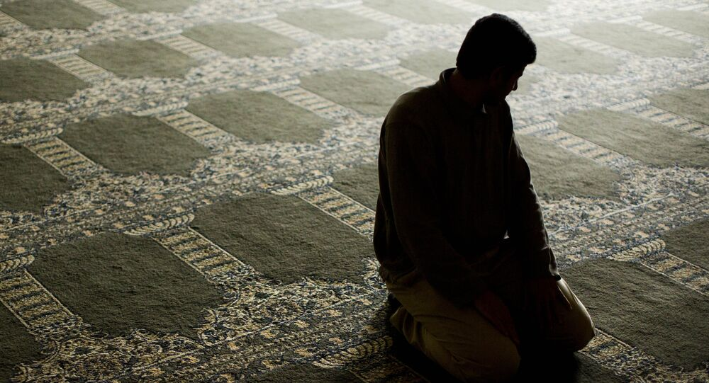 Syrian refugee prays at the Muslim Association of Lehigh Valley in Whitehall, Pa