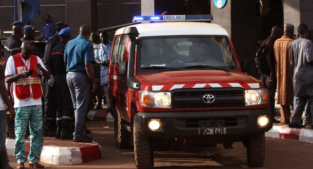 An ambulance seen outside the Radisson Blu hotel, after an attack by gunmen on the hotel, in Bamako, Mali, Friday, Nov. 20, 2015. Islamic extremists armed with guns and grenades stormed the luxury Radisson Blu hotel in Mali's capital Friday morning, and security forces worked to free guests floor by floor.