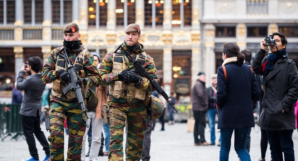 Belgian Army soldiers patrol in the picturesque Grand Place in the center of Brussels on Friday, Nov. 20, 2015.