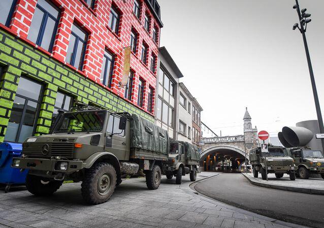 Army trucks stand in the Jewish neighborhood close to the Antwerp Centraal railway station in Antwerp, Belgium on November 20, 2015.