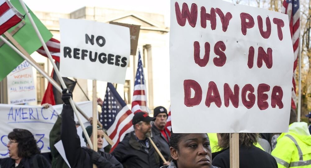 People gather to protest against the United States' acceptance of Syrian refugees at the Washington State capitol in Olympia, Washington, November 20, 2015