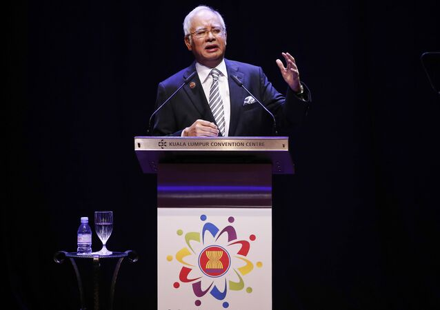 Malaysian Prime Minister Najib Razak speaks at the opening ceremony of the Association of Southeast Asian Nations (ASEAN) summit in Kuala Lumpur, Malaysia