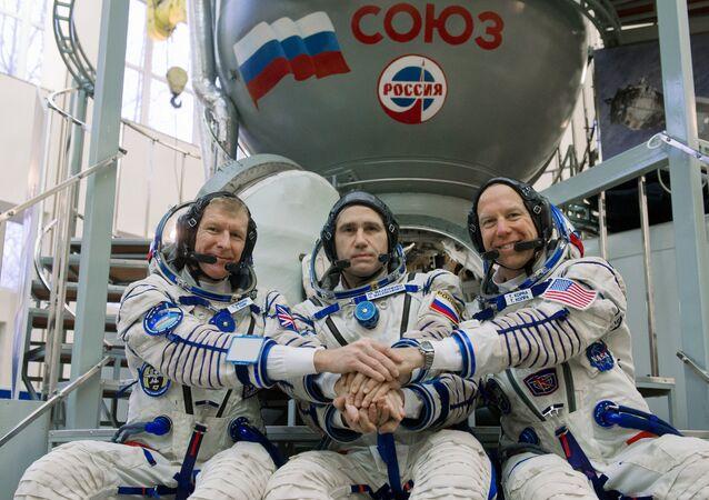 British ESA astronaut Timothy Peake, Russian cosmonaut Yuri Malenchenko and US NASA astronaut Timothy Kopra