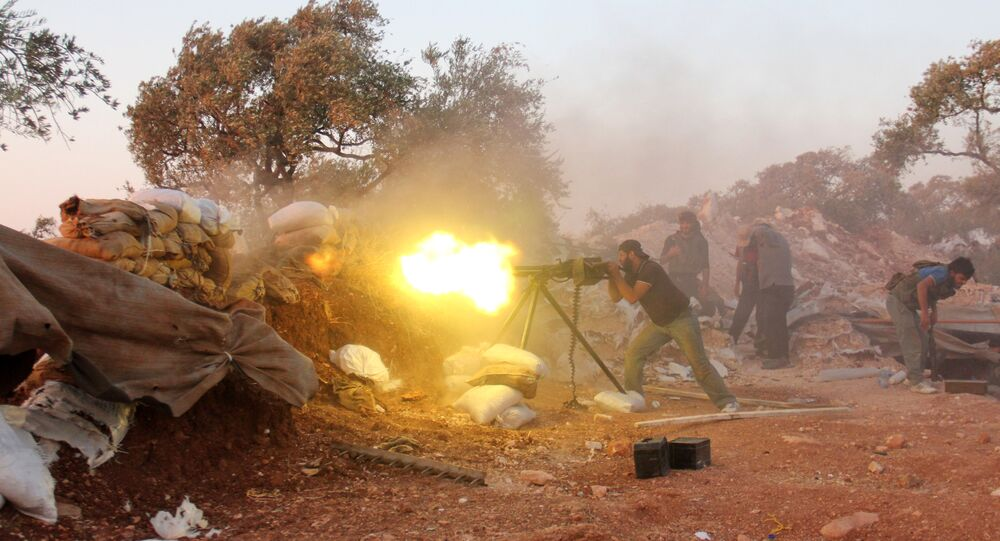 A rebel fighter fires a heavy machine gun during clashes with government forces and pro-regime shabiha militiamen in the outskirts of Syria's northwestern Idlib province on September 18, 2015