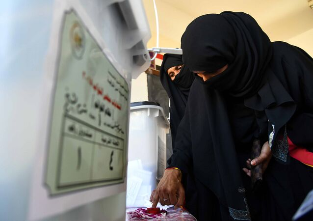 An Egyptian woman dips her finger in ink after casting her ballot at a polling station in the Red Sea resort of Sharm el-Shiekh on November 22, 2015, on the first day of the second and final round of the country's parliamentary elections